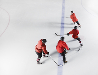 Hockey team in red uniforms skating on ice