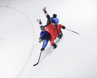 Hockey players colliding on ice