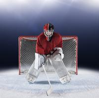 Portrait determined hockey goalie protecting goal net on ice 11086027989| 写真素材・ストックフォト・画像・イラスト素材|アマナイメージズ