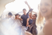 Young friends dancing at music festival