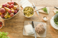 Overhead view pasta, fruit and bread on dining table