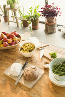 Pasta, fruit, bread, butter and asparagus on dining table