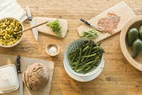 Overhead view lox, asparagus, pasta, bread and butter on dining table