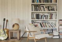 Home showcase guitars and books on bookshelf