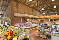 Market with brick walls and wood beam vaulted ceiling