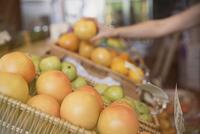 Close up fresh oranges in basket at market