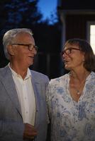 Senior couple smiling face to face