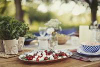 Caprese salad appetizer on patio table