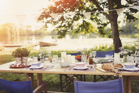Garden party lunch on table at idyllic lakeside