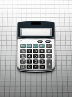 Calculator on grid gray background