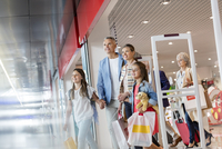 Family leaving duty free shop at airport