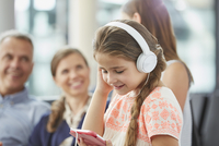 Girl listening to music with headphones and mp3 player
