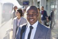 Portrait smiling businessman on train station platform