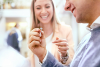 Jeweler helping man shopping for diamond ring in jewelry store