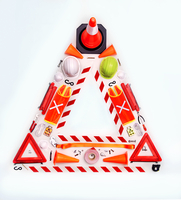 Still life concept construction equipment forming hazard triangle