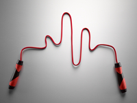 Red jump rope forming pulse trace on gray background