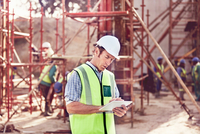 Construction worker using digital tablet at construction site
