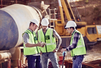 Construction workers meeting, using digital tablet at construction site 11086032673| 写真素材・ストックフォト・画像・イラスト素材|アマナイメージズ