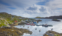 View of fishing boats in craggy harbor, Luskentyre, Harris, Outer Hebrides