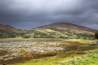 Storm clouds over tranquil rolling hills, Appin, Argyll, Scotland 11086032873| 写真素材・ストックフォト・画像・イラスト素材|アマナイメージズ
