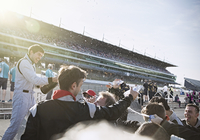 Formula one racing team and driver spraying champagne, celebrating victory on sports track 11086033644| 写真素材・ストックフォト・画像・イラスト素材|アマナイメージズ