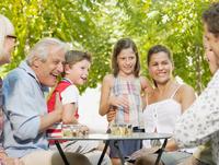 Family around garden table