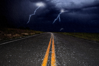 Lightning and hail on a road