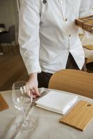 Sweden, Stockholm, Skeppsholmen, Person putting silverware on table