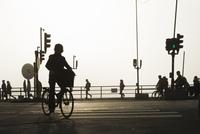 Sweden, Stockholm, Slussen, Silhouette of people on bridge