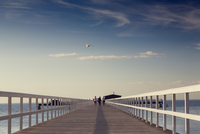Sweden, Skane, Malmo, Ribergsborg, Women walking on pier