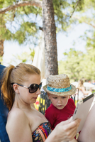 Turkey, Mugla, Marmaris, Mother and son (4-5) using tablet on summer holiday
