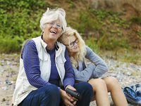 Denmark, Mon, Senior woman with granddaughter (16-17) laughing