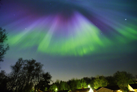Uppland, Sweden, Scenic northern lights over town