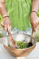 Sweden, Skane, Hoganas, Woman preparing salad in bowl
