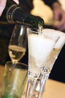 Sweden, Vastra Gotaland, Gothenburg, Groom pouring champagne