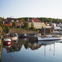 Denmark, Bornholm, Gudhjem, View of houses and harbor