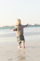 United Arab Emirates, Dubai, Boy (12-17 months) walking on beach