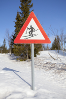 Norway, Trysil, Skier on warning sign