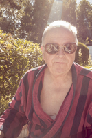 Sweden, Smaland, Anderstorp, Portrait of senior man wearing striped bathrobe and sunglasses