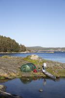 Sweden, West Coast, Bohuslan, Flato, Man camping on riverbank