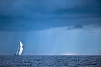 Antigua and Barbuda, Antigua, Sailboat in sea and rain cloud