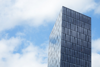 Iceland, Reykjavik, Office building with clouds