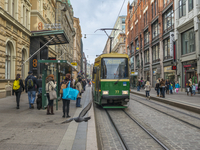 Finland, Helsinki, View of people waiting for tram