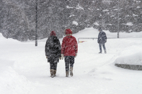 Finland, Helsinki, People walking in snow