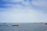 Sweden, Uppland, Runmaro, Barrskar, Boat on sea