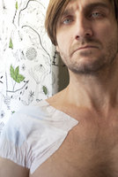 Sweden, Portrait of man with bandage on arm