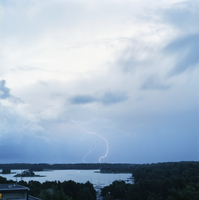 Finland, Helsinki, Roihuvuori, Stromsinlahti, Double lightning striking on horizon