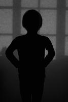 Sweden, Silhouette of boy in dark room
