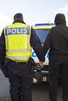 Sweden, Smaland, Jonkoping, Policeman arresting participant of demonstration
