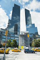 USA, New York City, Manhattan, View along zebra crossing leading towards two skyscrapers